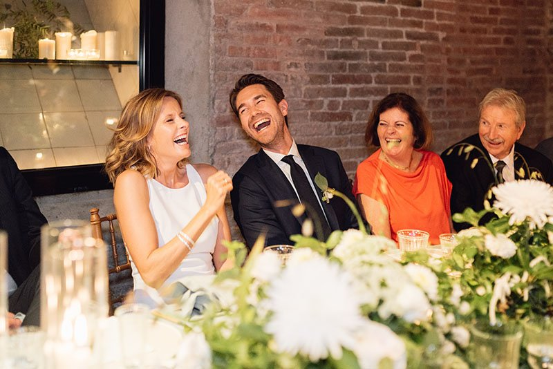 guests-laughing-at-dinner-table